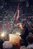 "Titre original :  Pierre Trudeau giving speech at ""NO"" referendum (flag in background)"