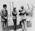 Original title:  H.R.H. the Prince of Wales and Lieutenant-Colonel W.G. Barker, V.C., preparing for flight in a Sopwith Gnu aircraft.