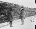 Original title:  Gen. Currie visits Cemetery in Andenne where 200 civilians were shot by Germans against a wall, 21st. August 1918.