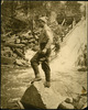 Titre original :  Tom Thomson, standing on a rock fishing in moving water.
