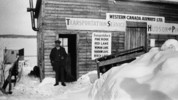 Titre original :  Western Canada Airways' first office at Hudson. The man in the doorway is J.A. McDougall, Treasurer of Western Canada Airways.