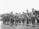 Original title:  General H.D.G. Crerar, General Officer Commanding 1st Canadian Army, and Captain C.B. Newman, Assistant Provost Marshal, 4th Canadian Armoured Division, inspecting a company of the Canadian Provost Corps, Apeldoorn, Netherlands, 12 July 1945.
