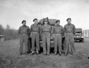 Original title:  General H.D.G. Crerar, General Officer Commanding-in-Chief First Canadian Army, with personnel of The Royal Montreal Regiment, in front of a Daimler armoured car, Grave, Netherlands, 11 April 1945.