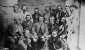 Titre original :    Description English: Councillors of the Provisional Government of the Métis Nation. Front row, L-R: Robert O'Lone, Paul Proulx. Centre row, L-R: Pierre Poitras, John Bruce, Louis Riel, John O'Donoghue, François Dauphinais. Back row, L-R: Bonnet Tromage, Pierre de Lorme, Thomas Bunn, Xavier Page, Baptiste Beauchemin, Baptiste Tournond, Joseph (Thomas?) Spence Français : Conseillers du gouvernement provisoire de la nation métisse Date 1870(1870) Source This image is available from Library and Archives Canada under the reproduction reference number PA-012854 and under the MIKAN ID number 3194516 This tag does not indicate the copyright status of the attached work. A normal copyright tag is still required. See Commons:Licensing for more information. Library and Archives Canada does not allow free use of its copyrighted works. See Category:Images from Library and Archives Canada. Aut