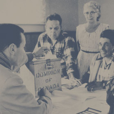 Original title:  Photograph of election officers at Hiawatha Council Hall, near Rice Lake, Ontario, during the first federal election in which all adult aboriginal people in Canada could exercise their right to vote (from left to right: Lawrence Salleby, Chief Ralph Loucks, Lucy Musgrove, Eldon Muskrat), October 31, 1960